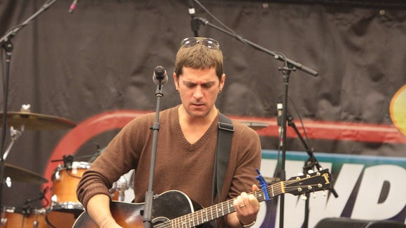 Singer Rob Thomas performs during 95.5 WPLJ's Scott & Todd Morning Show live broadcast at the 22nd Annual Holiday Radio Broadcast to Benefit Blythedale Children's Hospital in Valhalla Dec. 20, 2013. ( Matthew Brown  / The Journal News )