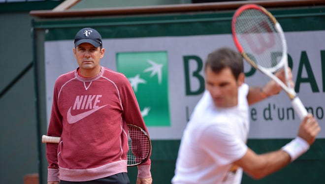 Paul Annacone (left) says he is still friends with Roger Federer even though he is no longer a primary coach.