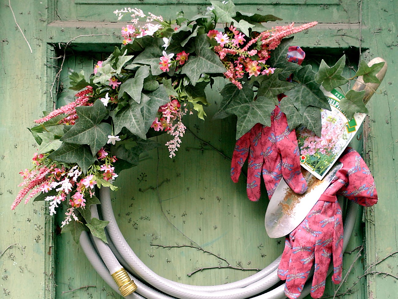 Adorn your front door or garden gate with this wreath fashioned from old garden tools.