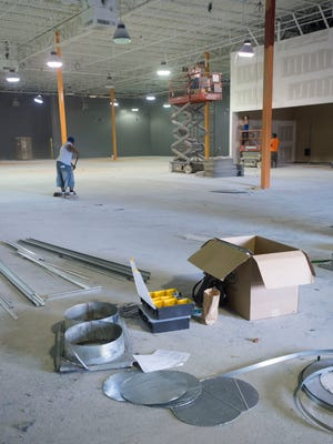 Construction crews work to renovate the former Omni Fitness building on North Davis Street into the new Sky Zone trampoline park. The new recreation center is scheduled to open by mid-summer.