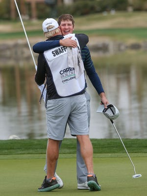 Hudson Swafford hugs his caddie D.J. Nelson after winning the the CareerBuilder Challenge at PGA West, January 22, 2016.