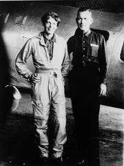 Amelia Earhart and her navigator, Fred Noonan, in front