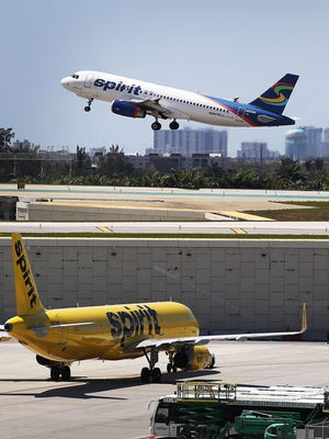 "A Spirit Airlines plane takes off at Fort Lauderdale-Hollywood International Airport on May 9, 2017. ""Ultra"" low cost airlines like Spirit and Frontier are notorious for charging fees."