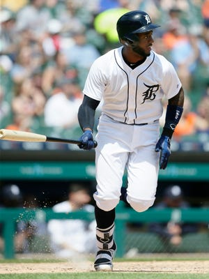 Niko Goodrum watches his sacrifice fly ball that drives in John Hicks during the seventh inning.