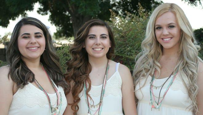 Visalia Holy Ghost Senior Queen Madison Machado, center, and her attendants, Ducati Dillon, left, and Lindsey Avila.