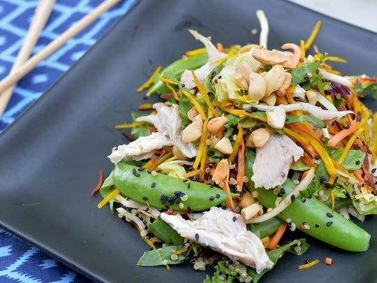 Quinoa, snap peas, cabbage, cashews and rotisserie chicken are tossed with a warm vinaigrette in this Asian chicken salad.