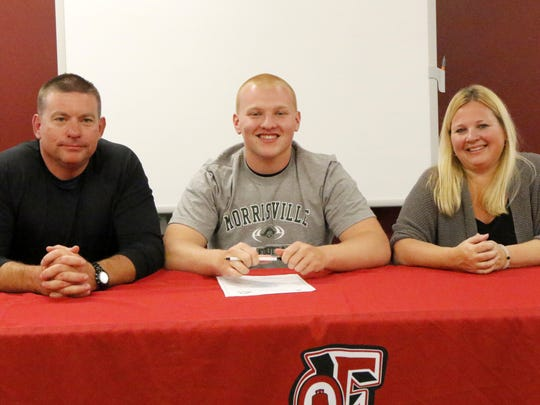Elmira football player Troy Dygert with his parents,