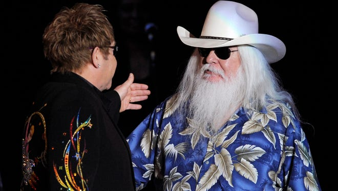 Elton John, left, greets Leon Russell on the stage during their joint concert at the Hollywood Palladium in 2010. The musicians collaborated on album 'The Union.'