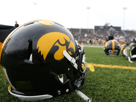 A Hawkeye helmet sits on the sideline after practice on Saturday during the Iowa Hawkeyes football team practice at Valley High Stadium in West Des Moines.