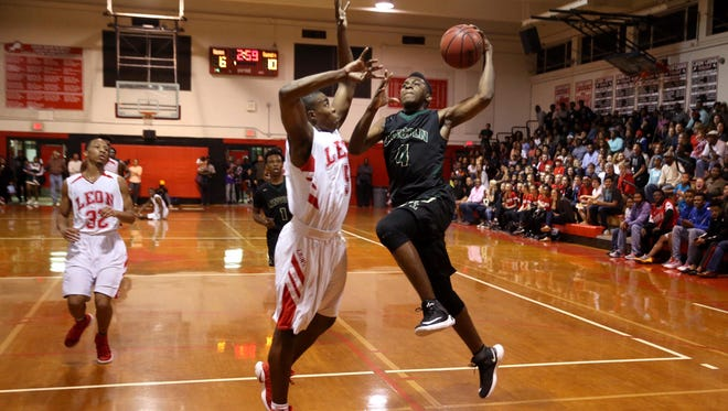 Lincoln's Trinton Bryant lays the ball up against Leon's Israel Chipman during their game at Leon High School on Friday.