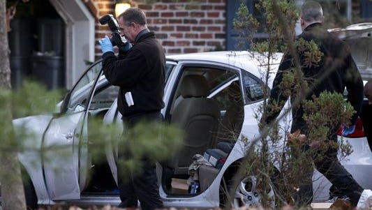 Investigators work outside the Tabernacle home where New Jersey State Police say Jeannine LePage, 44, shot her three children before turning the gun on herself.