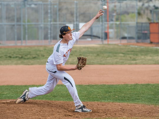 Aztec pitcher Kyler Duggins throws a pitch during a game against Farmington on Thursday in Aztec.
