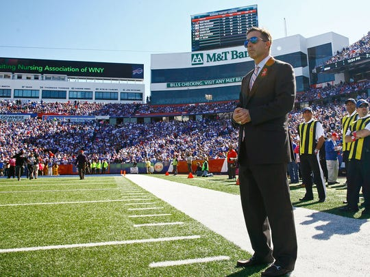 ORCHARD PARK, NY - OCTOBER 12:  President and Chief Executive Officer Russ Brandon of the Buffalo Bills watches warm-ups before the first half against the New England Patriots at Ralph Wilson Stadium on October 12, 2014 in Orchard Park, New York.  (Photo by Michael Adamucci/Getty Images)