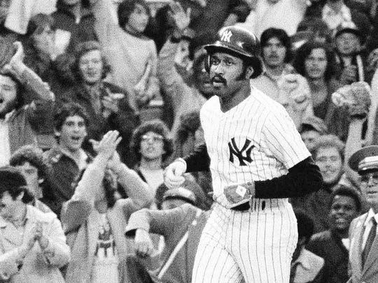 FILE - In this June 6, 1976, file photo, New York Yankees' Oscar Gamble heads for home plate after hitting a ninth inning home run to beat the Oakland A's 5-2 in the second baseball game of a doubleheader at Yankee Stadium in New York. Gamble, an outfielder who hit 200 home runs over 17 major league seasons, died Wednesday, Jan. 31, 2018, of a rare tumor of the jaw. He was 68. (AP Photo/Ray Stubblebine, File)