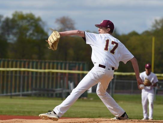 Arlington's Matt McGowan winds up a pitch during Wednesday's