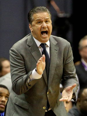 Kentucky coach John Calipari yells at his team during the first half of the Wildcats' win over LSU Tuesday night.