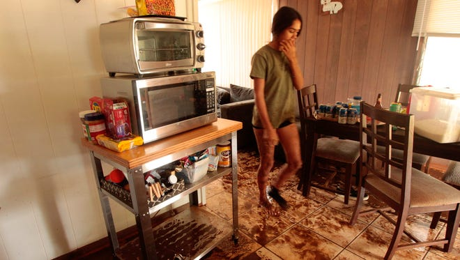 Thirteen-year-old Neveah Okuno walks in the living room of her home on April 16, 2018 in Koloa, Kauai.