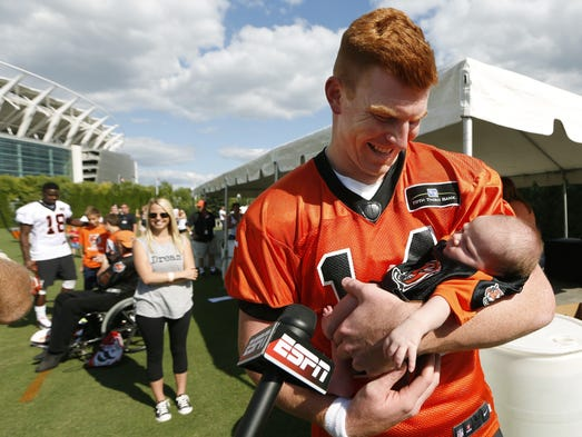 Cincinnati Bengals quarterback Andy Dalton and his three-week-old baby Noah were interviewed after practice at training camp downtown.