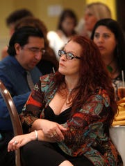 Yvonne Feckovic from Innovative Health Magazine attends the ÒSouthwest Florida Mayors Going GlobalÓ panel discussion Wednesday at The Landings Fort Myers.