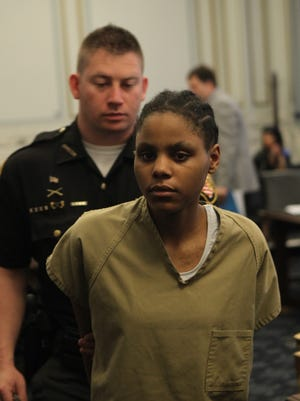 De'asia Watkins, charged with aggravated murder for allegedly beheading her infant daughter, leaves court after a competency hearing. Judge Charles Kubicki Jr. ruled she is presently incompetent to stand trial. She will be placed in Summit Behavioral Health Care, a lockdown treatment facility and re-evaluated in October.