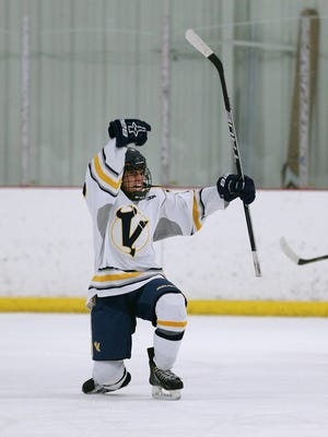 Victor's Alex Hernandez celebrates his second period goal against Penfield.