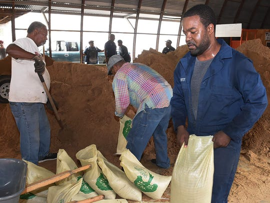 St. Landry Parish residents fill sandbags in preparation for Tropical Storm Cindy.