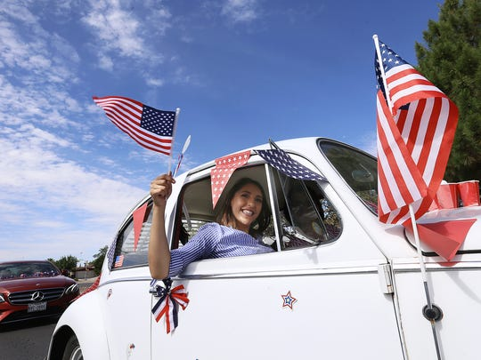 A decorated Volkswagen Bettle cruises the 41st Lion's People's Fourth of July Parade route Wednesday morning along Yarbrough Drive.