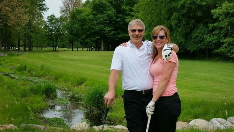 Tony and Janet Blundy stand near the tee boxes of the