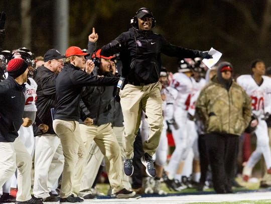 Central coach Bryson Rosser celebrates after a touchdown against South-Doyle on Friday.