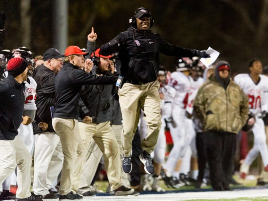 Central Head Coach Bryson Rosser celebrates after a touchdown during a game between South-Doyle and Central high schools at South-Doyle High School in Knoxville, Tennessee on Friday, November 17, 2017.
