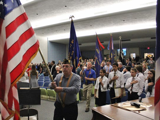 Everyone stood during the Presentation of the Colors.