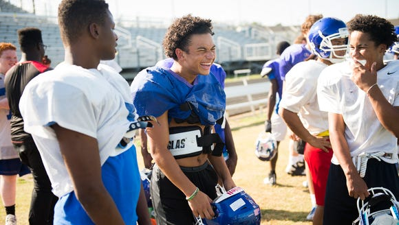 Isaiah Bailey laughs with his teammates during Wednesday's
