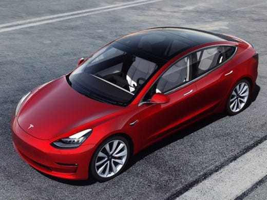 A Red Tesla Model 3 Performance High Electric Compact Luxury Sedan
