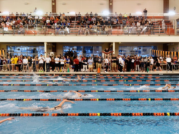 West York's Courtney Harnish, far right, swims the