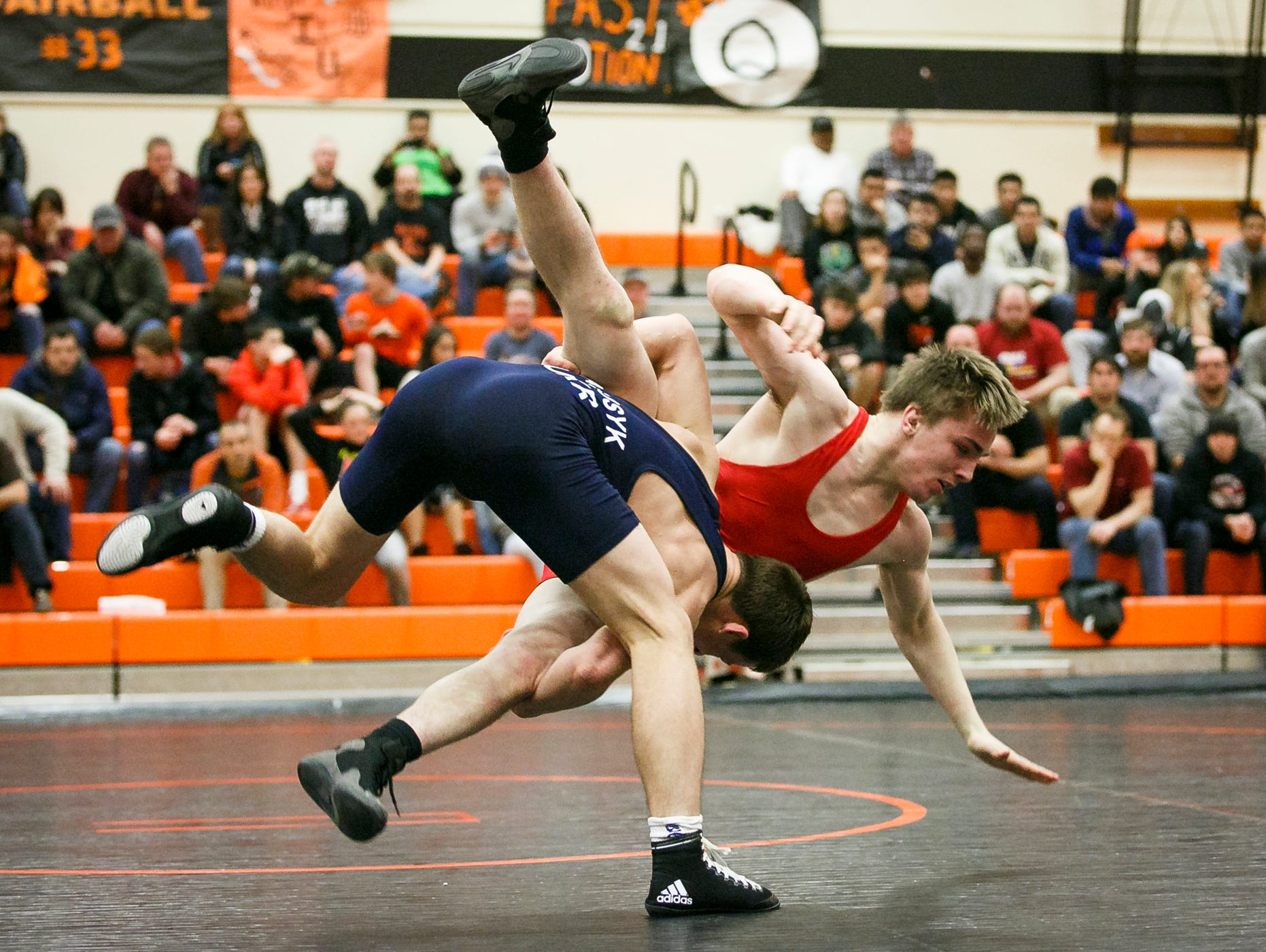 Sprague's Michael Murphy is taken down by Ukraine's Ivan Marusyk, left, in a match at Sprague High School on Tuesday, March 8, 2017. Members of the Ukrainian Junior National Team are touring Oregon, and stopped in Salem to compete against area high school all-stars.