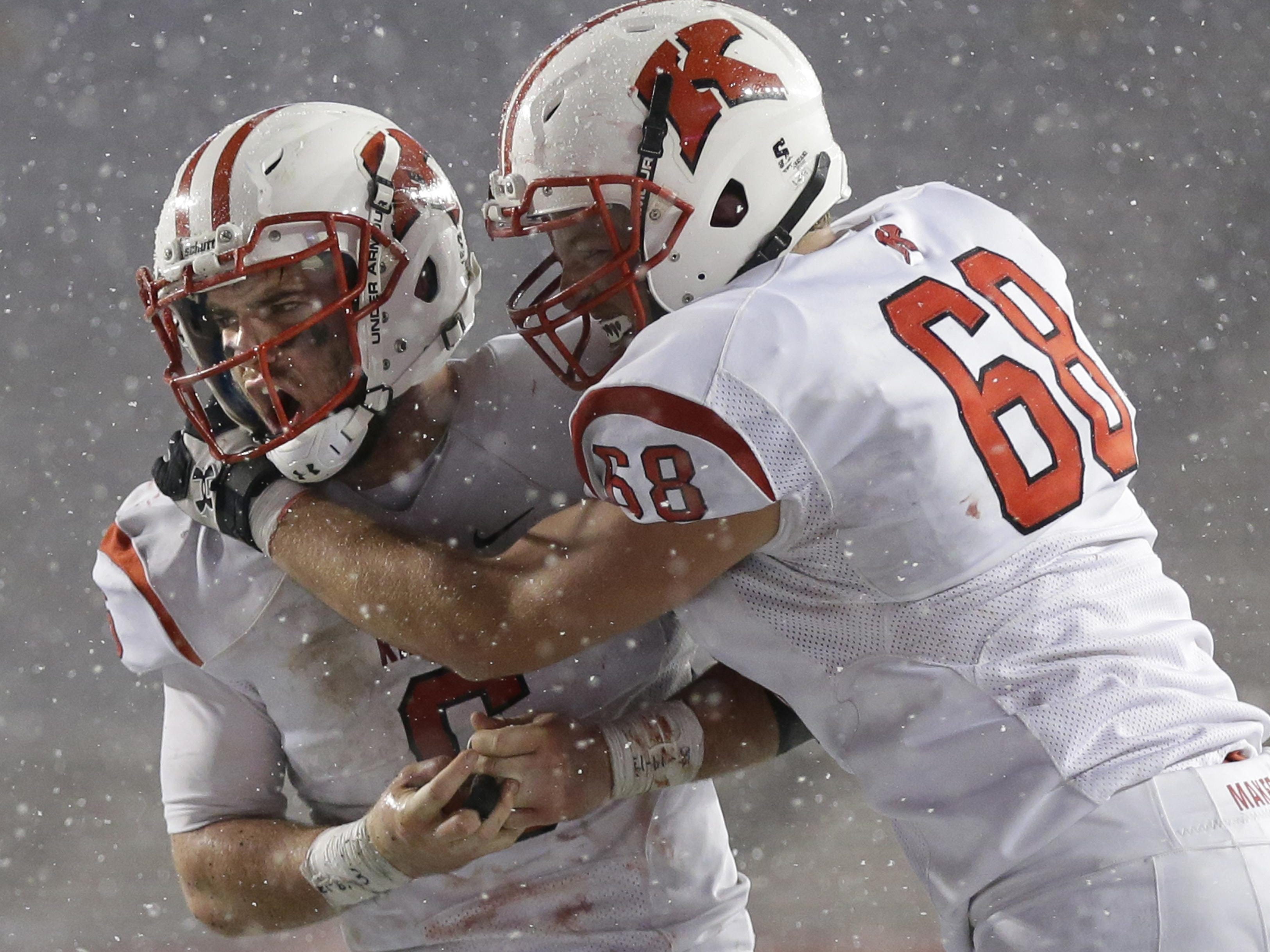 Kimberly's Blair Mulholland (left) celebrates his game-winning touchdown with Mickey Steger in the WIAA Division 1 state football championship game Friday at Camp Randall Stadium in Madison.