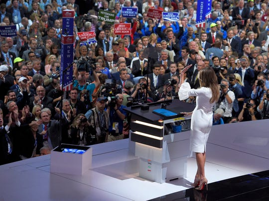 Melania Trump, wife of Republican Presidential Candidate Donald Trump waves to the delegates after her speech during the opening day of the Republican National Convention in Cleveland, Monday, July 18, 2016. (AP Photo/Mark J. Terrill)