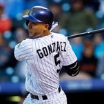 Colorado Rockies' Carlos Gonzalez flies out against the San Francisco Giants in the fourth inning of a baseball game Friday, May 22, 2015, in Denver. (AP Photo/David Zalubowski)