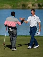 José de Jesús Rodríguez and Maverick McNealy shake hands after completing the final round of the United Leasing & Finance Championship at Victoria National Golf Course in Newburgh, Ind., Sunday, April 29, 2018. Rodríguez won the tournament, beating out McNealy, who was the leader going into round four.