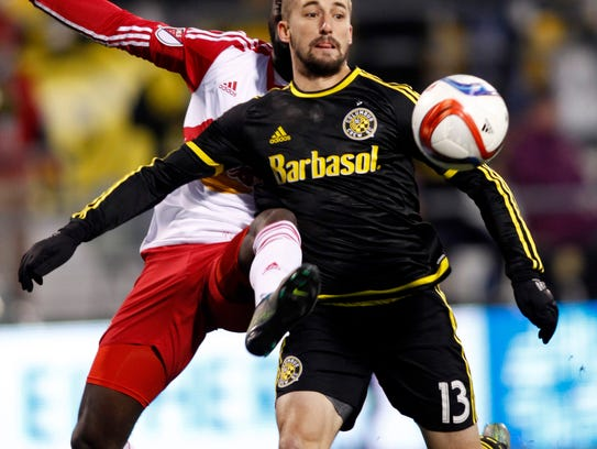 Columbus Crew midfielder Ethan Finlay, right, works