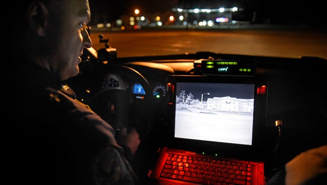 Sartell Police Sergeant Kelly Mader demonstrates a newly-installed thermal imagining unit Wednesday, March 2 on a Sartell squad car.