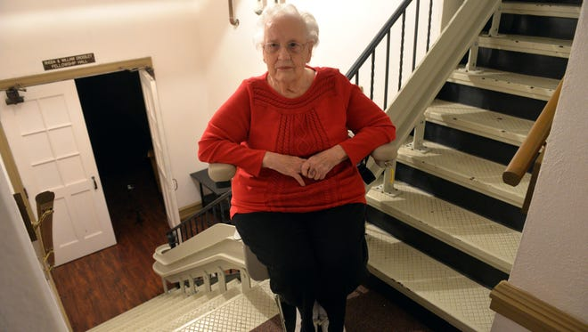 Marilyn Hatch, 86, of Vineland descends two flights of stairs to First United Methodist Church's fellowship hall using the newly installed chair lift.