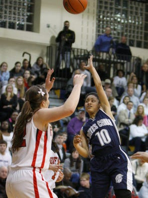 Gates Chili's Dejay Johnson, right, puts up a running hook over Penfield's Margot Hetzke, left.