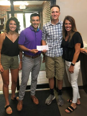 Waynedale High School graduate Matt Weaver was named the recipient of the Sean Carmichael Memorial Scholarship. Pictured from left to right are Zoe Carmichael, Parker Carmichael, Weaver and Angie Carmichael.