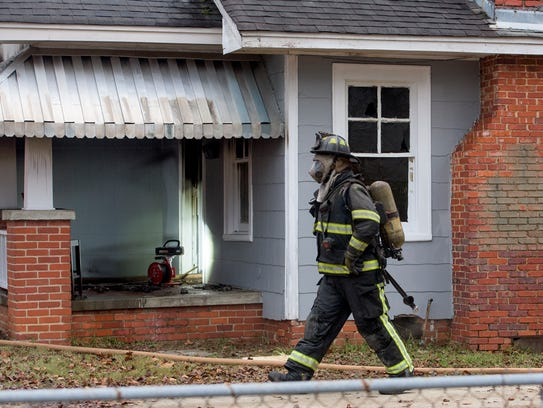 The Montgomery Fire Department works a house fire on