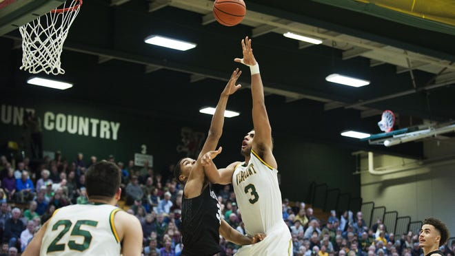 Vermont's Anthony Lamb (3) leaps to take a shot in a men's basketball game between the Harvard Crimson and the Vermont Catamounts during the 2016-17 season.