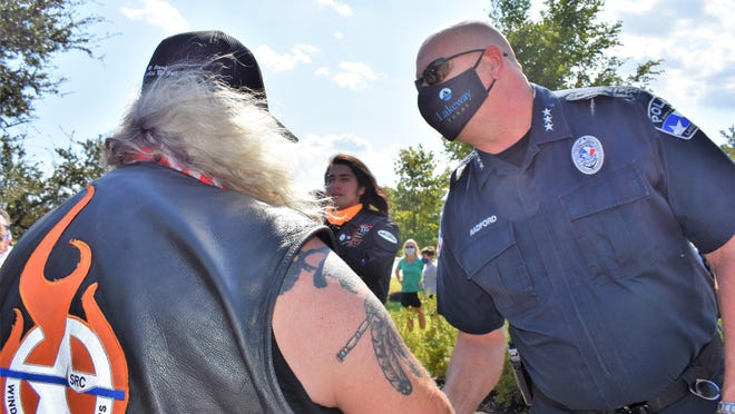Lakeway Police Chief Todd Radford greets a member of the Wind Therapy Freedom Riders during Saturday's rally supporting the department.