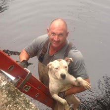 MPO Randy Lopez rescued the scared dog