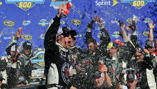 Kevin Harvick celebrates in victory lane at Phoenix International Raceway for the fifth time in the past six races there.