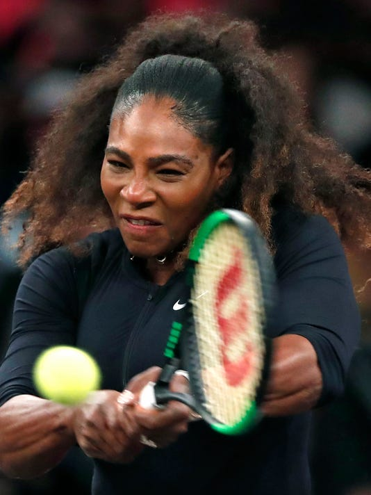 Serena Williams of the United States returns to opponent Zhang Shuai of China during the semi-final round of Tie Break Tens tennis tournament at Madison Square Garden, Monday, March 5, 2018 in New York. The Tie Break Tens' New York event is a one-day day exhibition tournament featuring eight female players competing for a $250,000 winner's prize. (AP Photo/Kathy Willens)